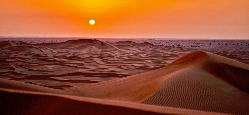 Desert dunes at sunset