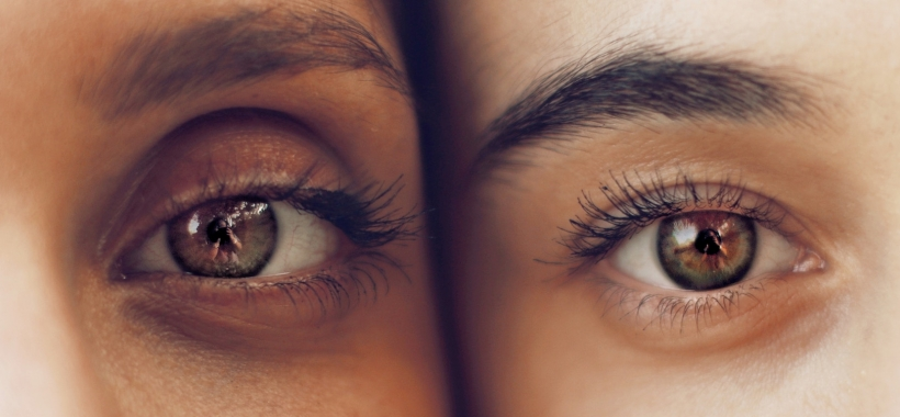Close-up of eyes of two women