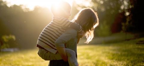 Girl giving boy a piggyback ride