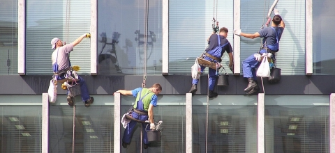 Window washers suspended from high rise