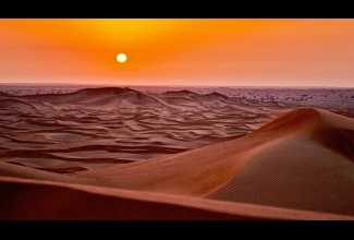 Desert dunes at sunset
