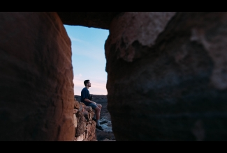 Man sitting on rock formation