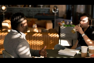 Two men in conversation at coffee shop
