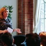 Tara Muldoon, founder of F-You: The Forgiveness Project speaking at an event.