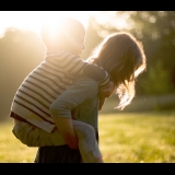 Girl giving boy a piggyback ride