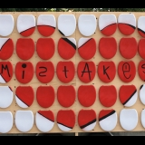 Red heart image made of toilet seats with mistakes written in middle