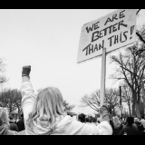 """Woman holding sign saying """"We are better than this"""" at Women's March in DC"""