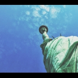 view from underneath the Statue of Liberty with blue sky above
