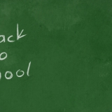 green chalkboard with back to school in white chalk
