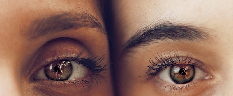 close up of 2 eyes of 2 different people