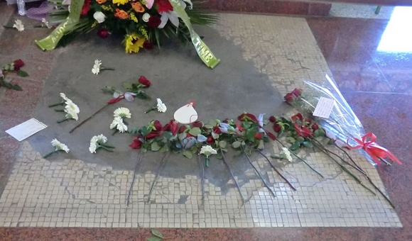 Floral memorial in the waiting room of the Bologna Central Station in August 2012.