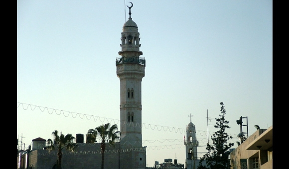 Mosque stands near Catholic Church in Amman