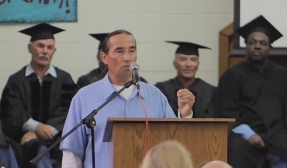 speaker at podium during graduation