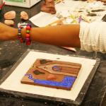 hand with paintbrush and ceramic glaze