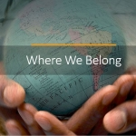 """Where We Belong"" across globe cradled in two hands"