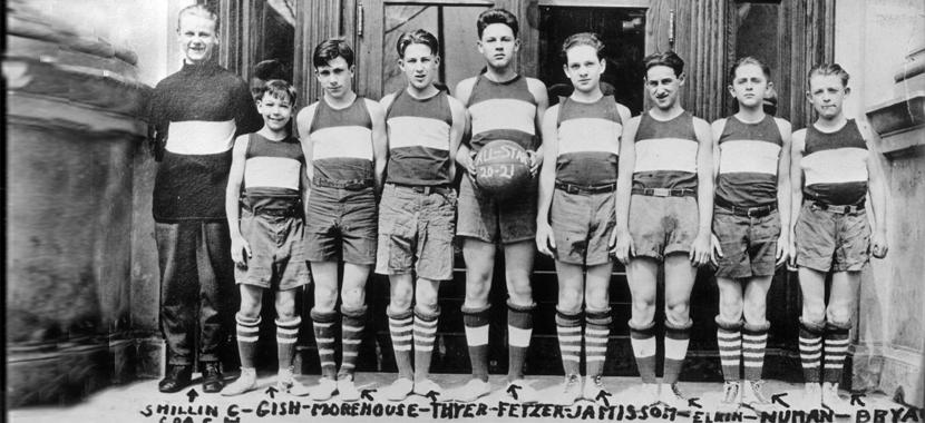 A black and white photo of John Fetzer with his youth basketball team. He is the tallest player.
