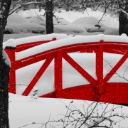 Red foot bridge in snow