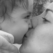 bw image of mother and baby kissing