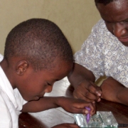 Child using Braille Tutoring Device