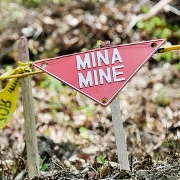 Sign warning of land mine in Bosnia