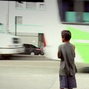 Young boy watching traffic